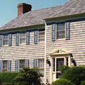 Asphalt roof with stained cedar shingle siding